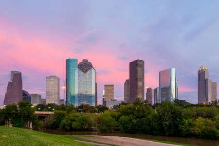 Houston, Texas  skyline at sunset twilight from park lawn