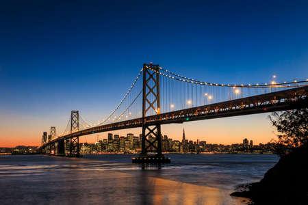 San Francisco skyline and Bay Bridge at sunset, California USA Stock fotó - 38929732