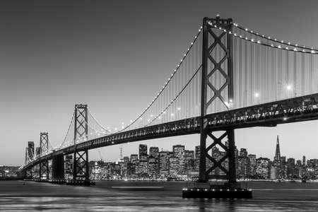 San Francisco skyline and Bay Bridge at sunset in black and white Фото со стока - 38929734