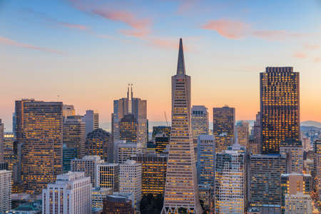 san: Beautiful view of  business center in downtown San Francisco at sunset.