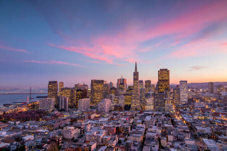 coit tower: Beautiful view of  business center in downtown San Francisco at sunset.
