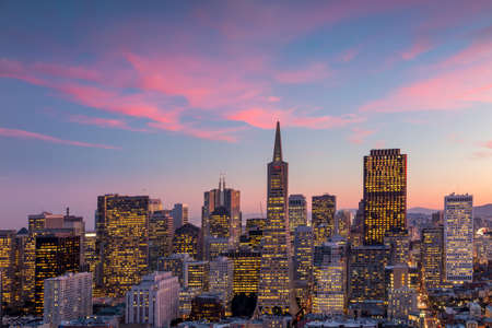 coit: Beautiful view of  business center in downtown San Francisco at sunset.