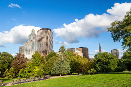 hi res: Highrise buildings along Bushnell park, downtown Hartford with blue sky Stock Photo