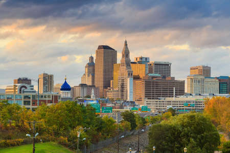 scenic view: Skyline of downtown Hartford, Connecticut from above Charter Oak Landing at sunset.