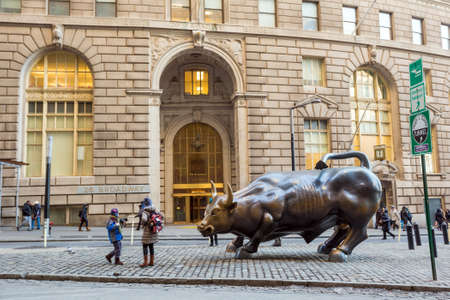 NEW YORK CITY - FEB 11: The landmark Charging Bull in Manhattan represents aggressive financial optimism and prosperity on February 11, 2015. in New York City.