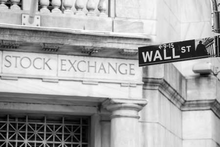 Wall street sign in New York City in black and white