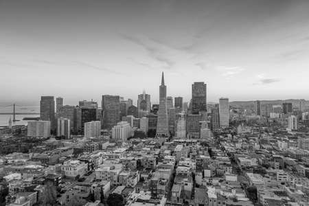 coit tower: Beautiful view of  business center in downtown San Francisco at sunset black and white