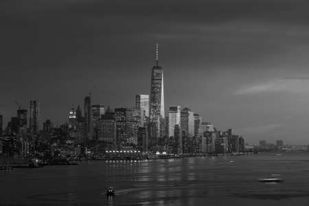 hudson: New York City with skyscrapers illuminated over Hudson River panorama, including the One World Trade Center