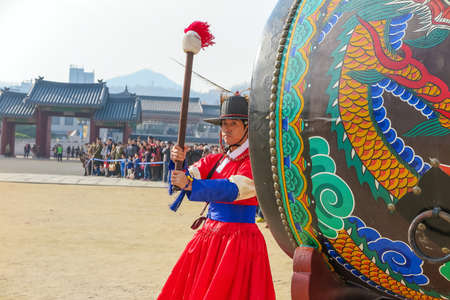 pageant: Seoul, South Korea-NOV 7: The ceremony changing of the guards at Gyeongbokgung Palace on November 7, 2014 in Seoul, Korea. The guards wear colorful uniforms in the pageant.
