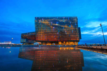 concert hall: REYKJAVIK, ICELAND - March 23: Twilight scene of Harpa Concert Hall in Reykjavik, Iceland on March 23, 2015. The Harpa Concert Hall is the new landmark of the city, build in 2011.