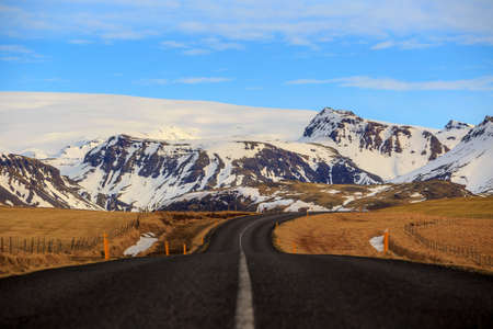 snow covered mountains: Road leading to snow covered mountains, Iceland Stock Photo