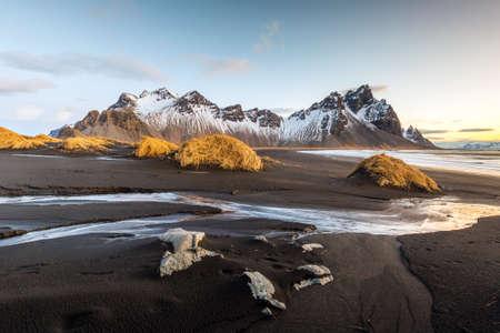 sand: Vesturhorn Mountain and black sand dunes, Iceland Stock Photo
