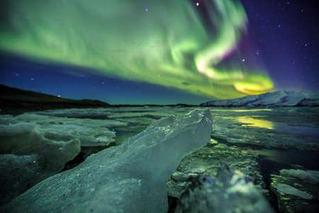 auroral: Auroral display over the glacier lagoon Jokulsarlon in Iceland.