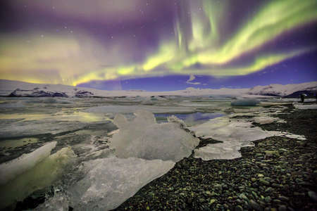 auroral: Auroral display over the glacier lagoon Jokulsarlon in Iceland.