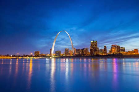 arch: St. Louis downtown at twilight.