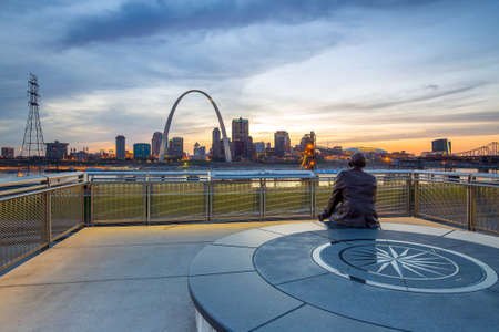 st  louis arch: City of St. Louis skyline. Image of St. Louis downtown with Gateway Arch at twilight.