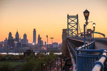 ben franklin: Panorama of Philadelphia skyline, Ben Franklin Bridge and Penns Landing sunset Stock Photo