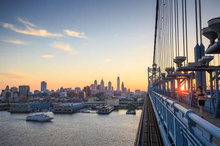 the franklin: Panorama of Philadelphia skyline, Ben Franklin Bridge and Penns Landing sunset Stock Photo