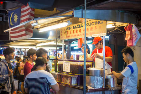 locals: KUALA LUMPUR, MALAYSIA - JUNE 25: Chinatown Street restaurant in heart of Kuala Lumpur, on June 25, 2015 in KL. Chinatown is very popular with tourists and locals.