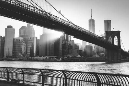 new york buildings: Brooklyn bridge at sunset, New York City in black and white Stock Photo