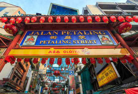 locals: KUALA LUMPUR, MALAYSIA - JUNE 24: Chinatown Street restaurant in heart of Kuala Lumpur, on June 24, 2015 in KL. Chinatown is very popular with tourists and locals.