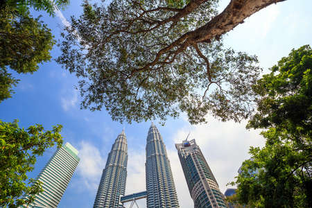 june 25: KUALA LUMPUR, MALAYSIA - June 25: Petronas Towers on June 25, 2015 in Kuala Lumpur, Malaysia.Petronas Towers is the tallest buildings in the world from 1998 to 2004