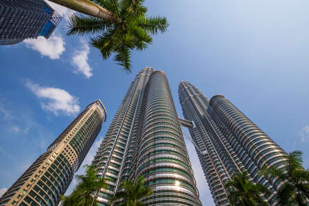 june 25: KUALA LUMPUR, MALAYSIA - June 25: Petronas Twin Towers on June 25, 2015 in Kuala Lumpur, Malaysia. Petronas Towers are twin skyscrapers and were tallest buildings in the world until 2004