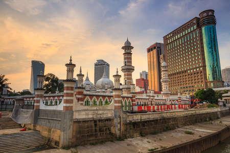 prayer tower: Historic mosque, Masjid Jamek at Kuala Lumpur, Malaysia at sunset