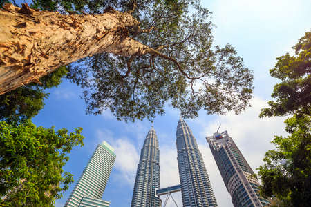 petronas: KUALA LUMPUR, MALAYSIA - June 25: Petronas Towers on June 25, 2015 in Kuala Lumpur, Malaysia.Petronas Towers is the tallest buildings in the world from 1998 to 2004