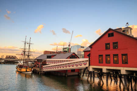 tea party: Boston Harbor and Financial District at sunset and Tea Party Ships & Museum in Boston, Massachusetts.