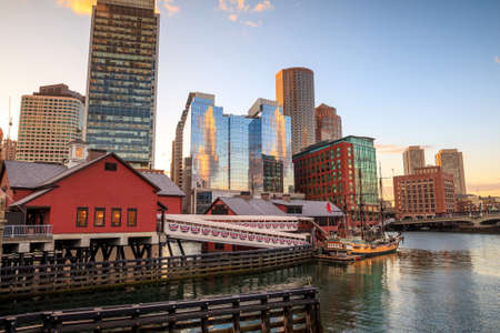 Boston Harbor and Financial District at sunset and Tea Party Ships & Museum in Boston, Massachusetts.
