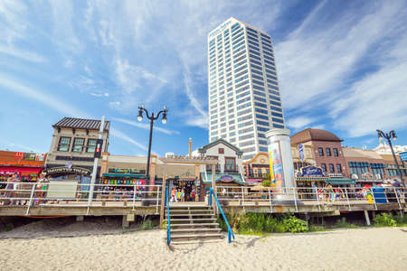 atlantic city: ATLANTIC CITY,  NEW JERSEY - August 3: The boardwalk and Casinos on August 3, 2015 in Atlantic City, New Jersey. Gambling was legalized in the city in 1976 and led to a resurgence. Editorial
