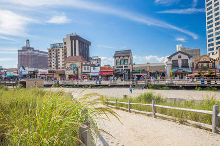 ATLANTIC CITY, NEW JERSEY - August 3: The boardwalk and Casinos on August 3, 2015 in Atlantic City, New Jersey. Gambling was legalized in the city in 1976 and led to a resurgence. Editorial