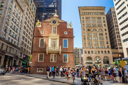 boston tea party: BOSTON, MA - AUGUST 13: A crowd of tourists and locals at Faneuil Hall, rated number 4 in Americas 25 Most Visited Tourist Sites by Forbes Traveler in 2008. As seen on August 13, 2015 in Boston, MA - USA.