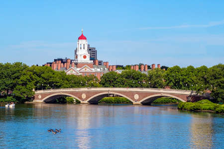 campus building: John W. Weeks Bridge with clock tower over Charles River in Harvard University campus Boston