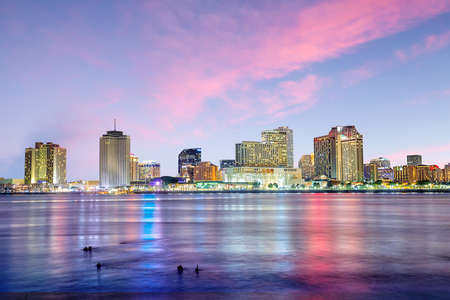 orleans: Downtown New Orleans, Louisiana and the Mississippi River at twilight Stock Photo