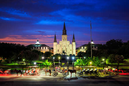 french: Saint Louis Cathedral and Jackson Square in New Orleans, Louisiana, United States at sunset