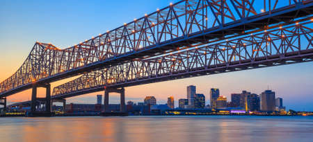river boat: The Crescent City Connection Bridge on the Mississippi river and downtown New Orleans Louisiana