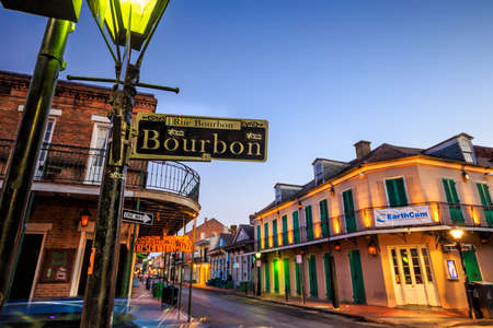 NEW ORLEANS, LOUISIANA - AUGUST 25: Bourbon Street sign with pubs and bars and neon lights  in the French Quarter, New Orleans on August 25, 2015.