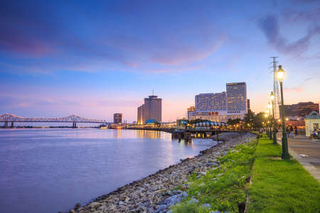 new: Downtown New Orleans, Louisiana and the Missisippi River at twilight