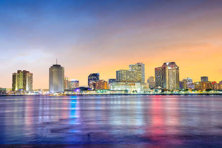 Downtown New Orleans, Louisiana and the Mississippi River at twilight 写真素材