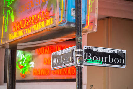 bourbon street: NEW ORLEANS, LOUISIANA - AUGUST 25: Bourbon street sign with Pubs and bars  in the French Quarter, downtown New Orleans on August 25, 2015.