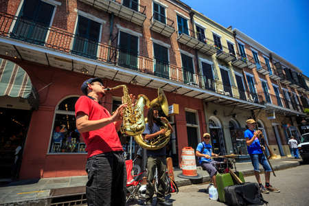 melodies: NEW ORLEANS - AUGUST 25: The French Quarter in New Orleans on August 25, 2015, a jazz band plays jazz melodies in the street for donations from the tourists