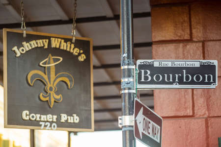 bourbon street: NEW ORLEANS, LOUISIANA - AUGUST 23: Bourbon street sign with Pubs and bars  in the French Quarter, downtown New Orleans on August 23, 2015.