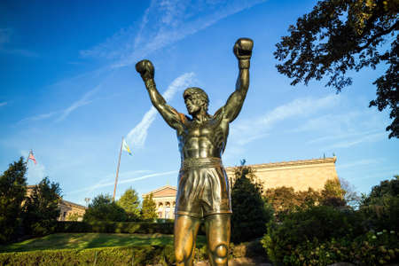 PHILADELPHIA - OCT 20: The Rocky Statue in Philadelphia, USA, on October 20, 2015. Originally created for the movie Rocky III, the sculpture is now a real-life monument to a celluloid hero Editorial