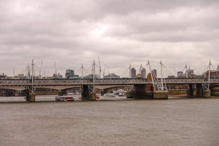 typically english: London skyline with River Thames in London UK
