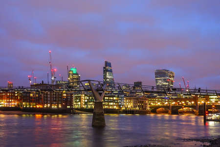 river scape: London city  at night, panoramic view from river