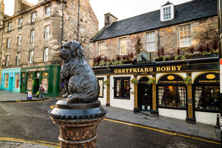 supposedly: EDINBURGH, SCOTLAND -DEC 10: A statue of Greyfriars Bobby in Edinburgh on December 10, 2015. Bobby was a dog who supposedly spent 14 years by the grave of his owner until he died in 1872.