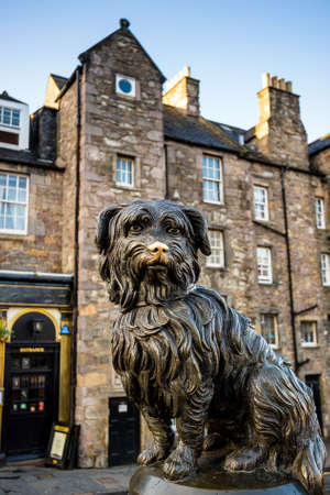 EDINBURGH, SCOTLAND -DEC 10: A statue of Greyfriars Bobby in Edinburgh on December 10, 2015. Bobby was a dog who supposedly spent 14 years by the grave of his owner until he died in 1872.