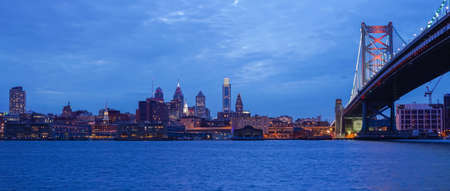 Philadelphia skyline reflected in the Delaware river under a twilight